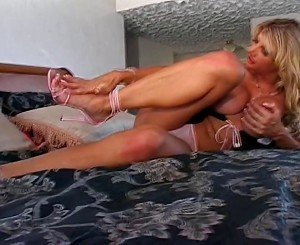 Hot big breasted blonde plays with her tits and spreads her legs for camera