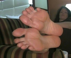 Big Feet Hanging off Couch