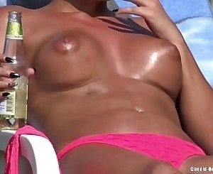 Hot Bikini Babes Tanning At The Pool