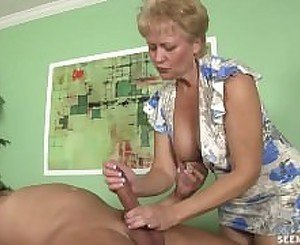 50 year old women handjob on tits