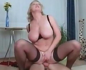 Busty MILF fucks and sucks